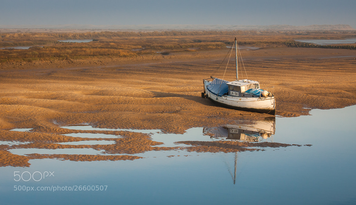 Photograph Stranded at Low Tide, Norfolk by Fraser McCallum on 500px