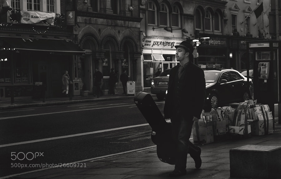 A musician walking streets of Dublin,Ireland.