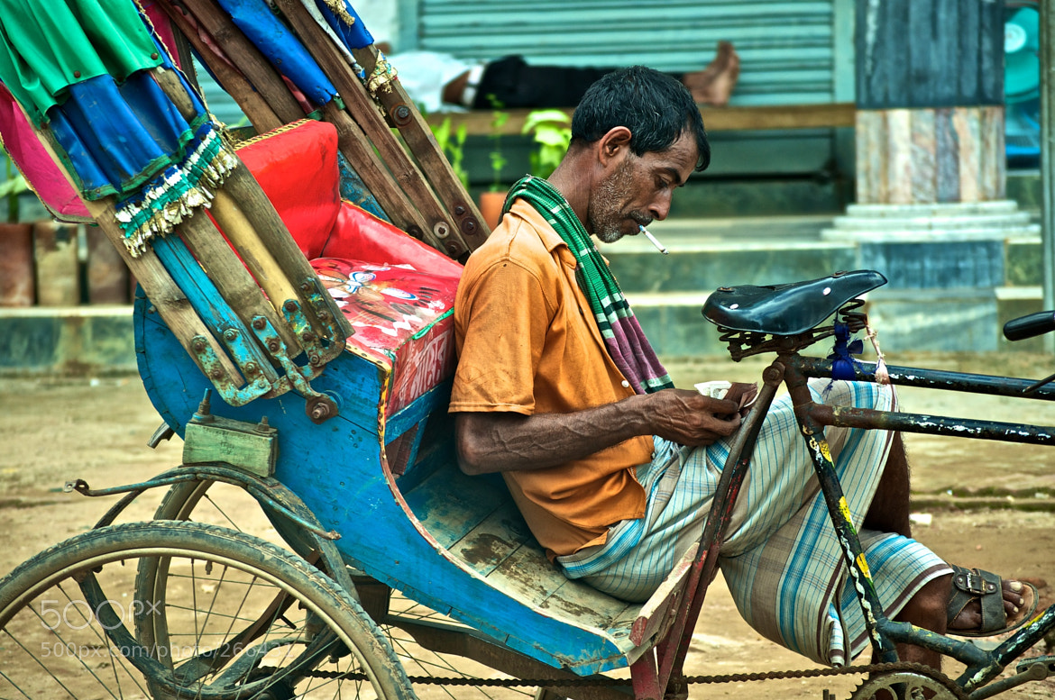 Photograph Rickshaw puller's break by Russell Rahman on 500px