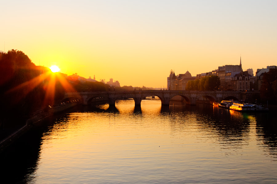 Sunrise from Pont des Arts with Pont Neuf and Cite Island int the background.