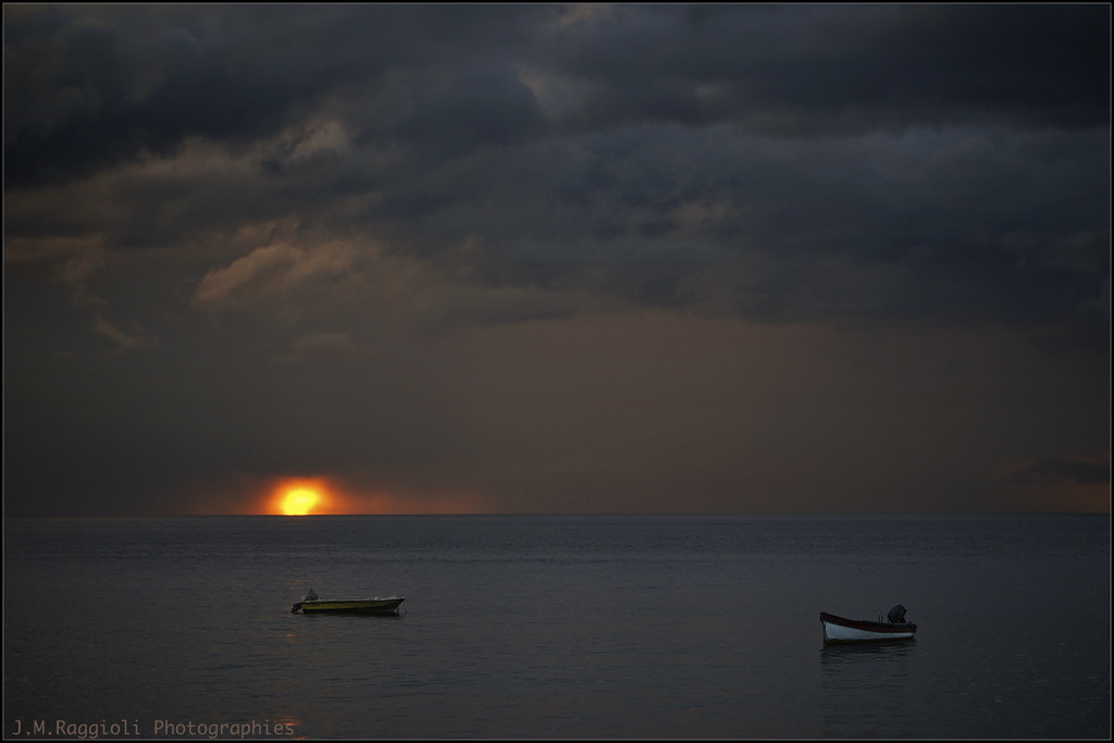Photograph Sunset between rainy clouds by Jean-Michel Raggioli on 500px