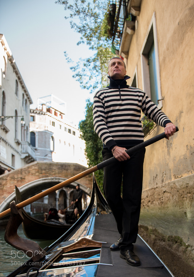 Photograph Elegant Gondolier in Venice by Lisa Osta on 500px