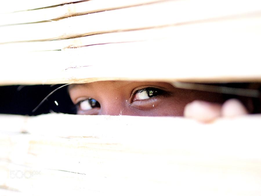 This cute Orang Asli kid is hiding behind the bamboo wall of his house. Not sure I peep him or he peeps me :) At Ulu Tamu, Selangor, Malaysia.