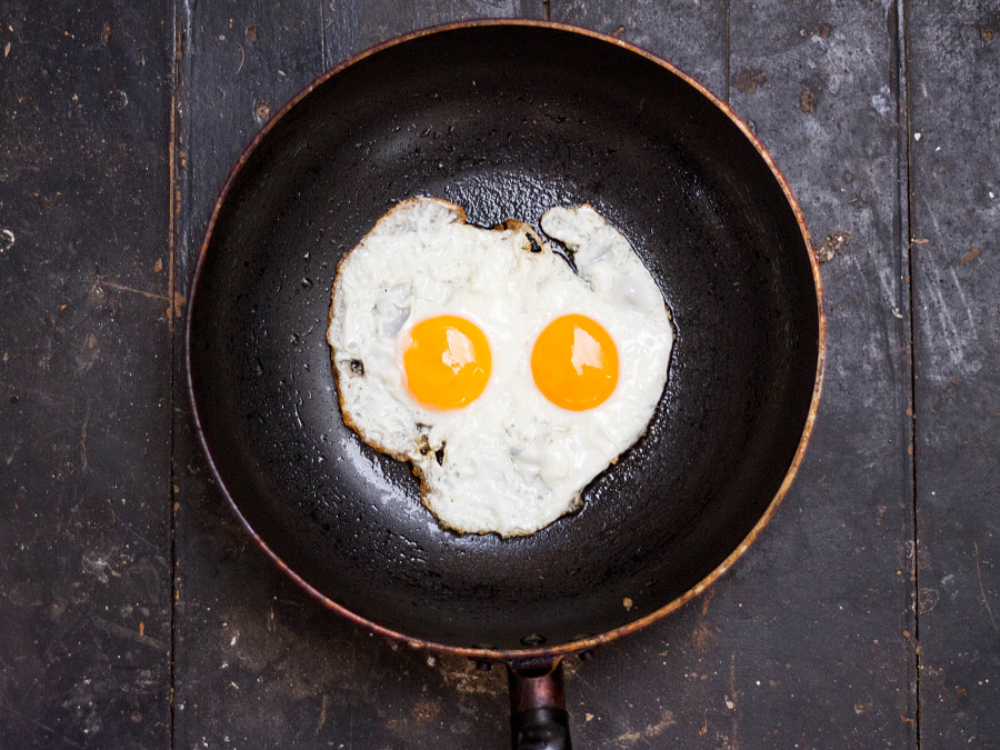 Fired eggs in a frying pan like a skull by Phuphan Sornwismongkol on 500px.com