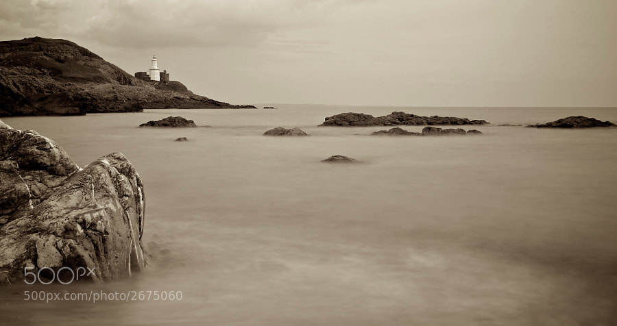 A long exposure at Bracelet Bay at the foot of the Mumbles lighthouse.