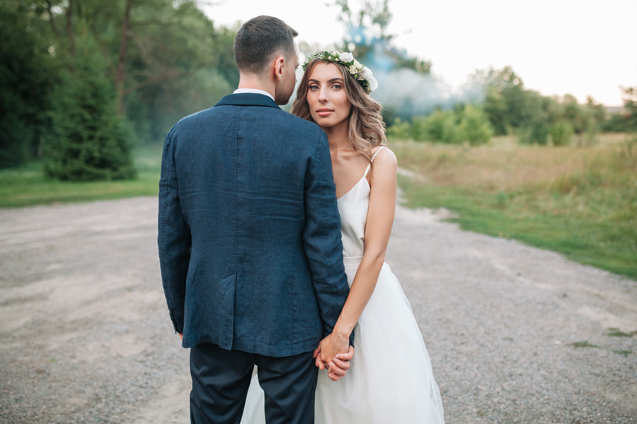 Bride and groom at wedding Day walking Outdoors on summer nature. Bridal couple, Happy Newlywed... by Andrii Afanasiev on 500px.com