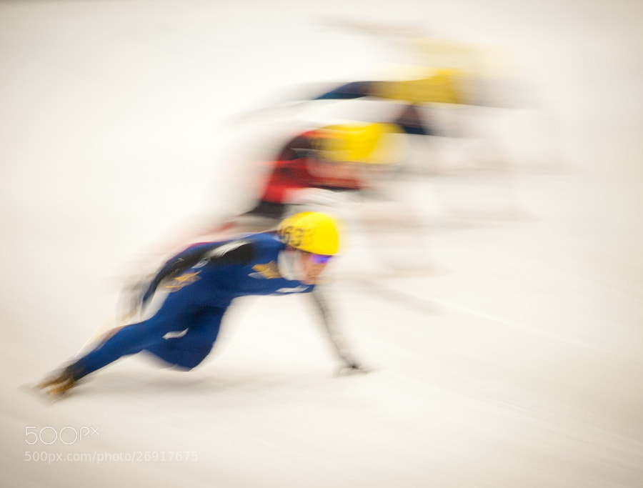 Blurry speed skaters