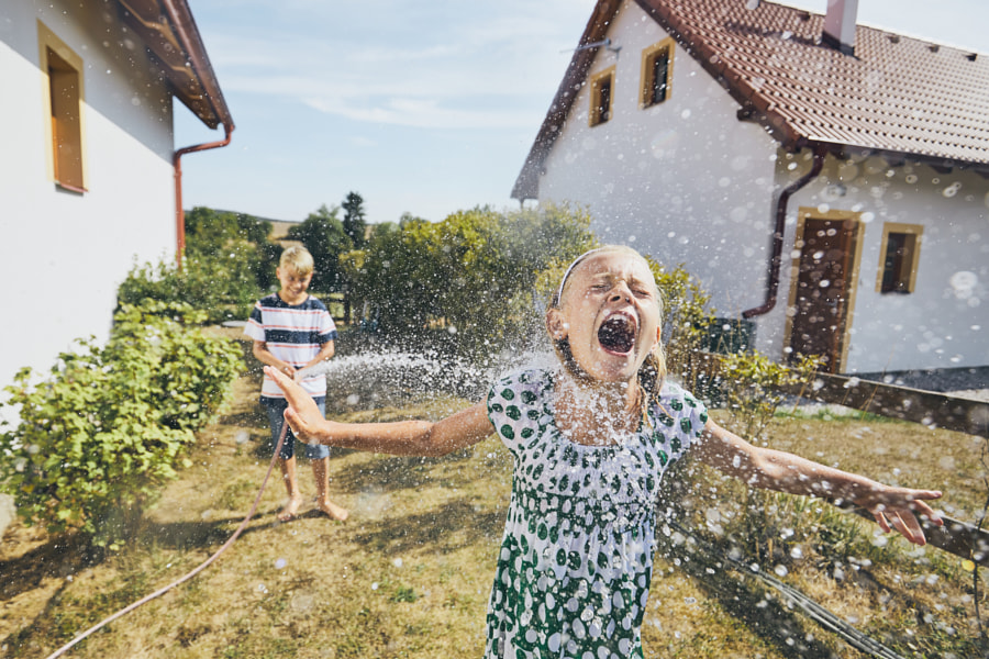 Children having fun with splashing water by Jaromír Chalabala on 500px.com
