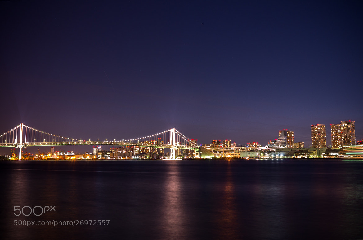 Photograph Tokyo waterfront night view (Rainbow Bridge and buildings )  by Aki Ono on 500px