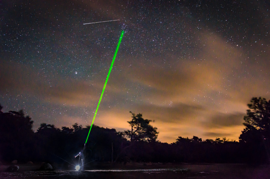 Catching shooting star with laser by Kristian D. Hansen ✅