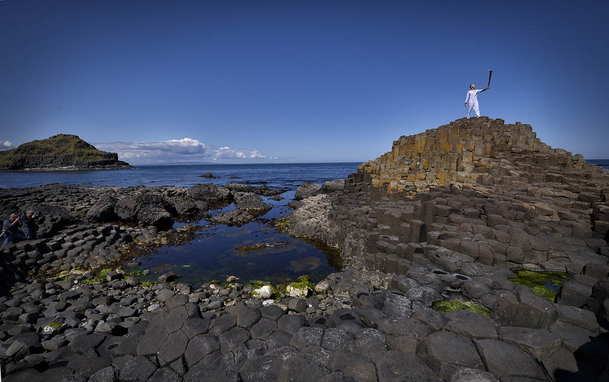 Photograph Olympic Torch at Giants Causeway by Russell Pritchard on 500px