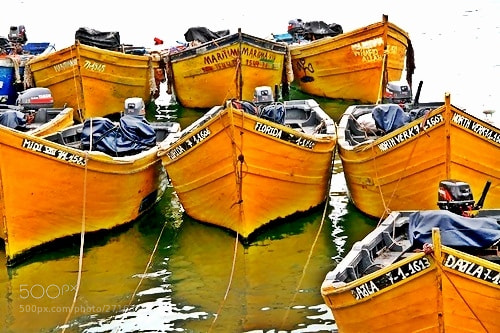 Photograph yellow boats by Tet Cioco  on 500px