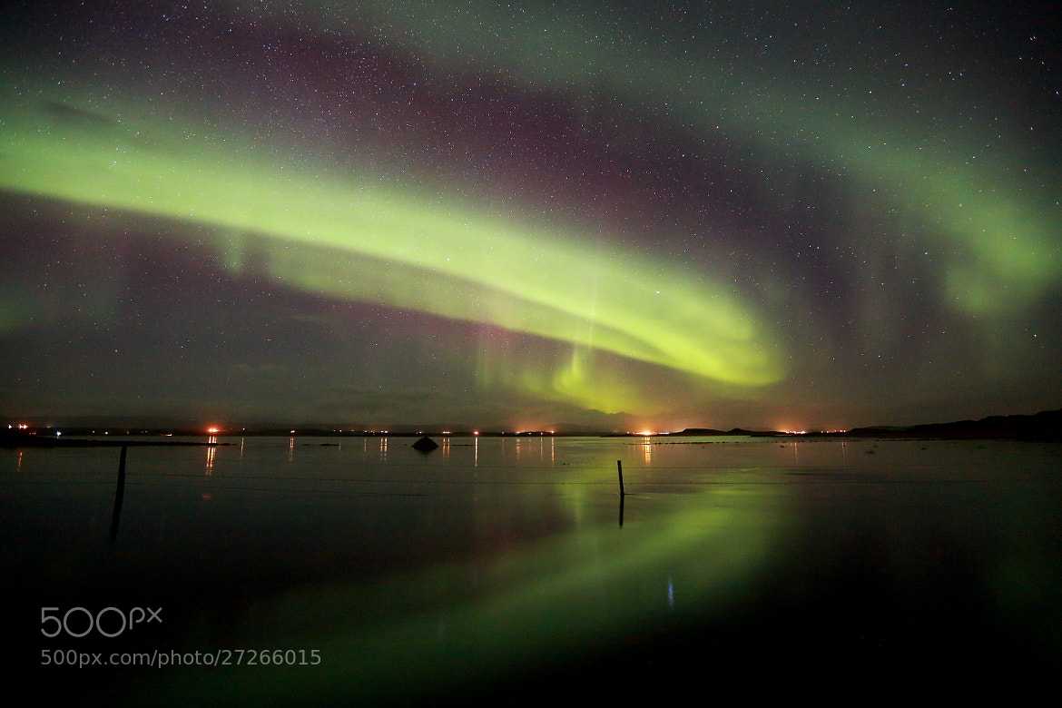Photograph Aurora Borealis reflection by Jon Hilmarsson on 500px