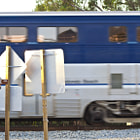 Amtrak train rushing by in Summerland, California.