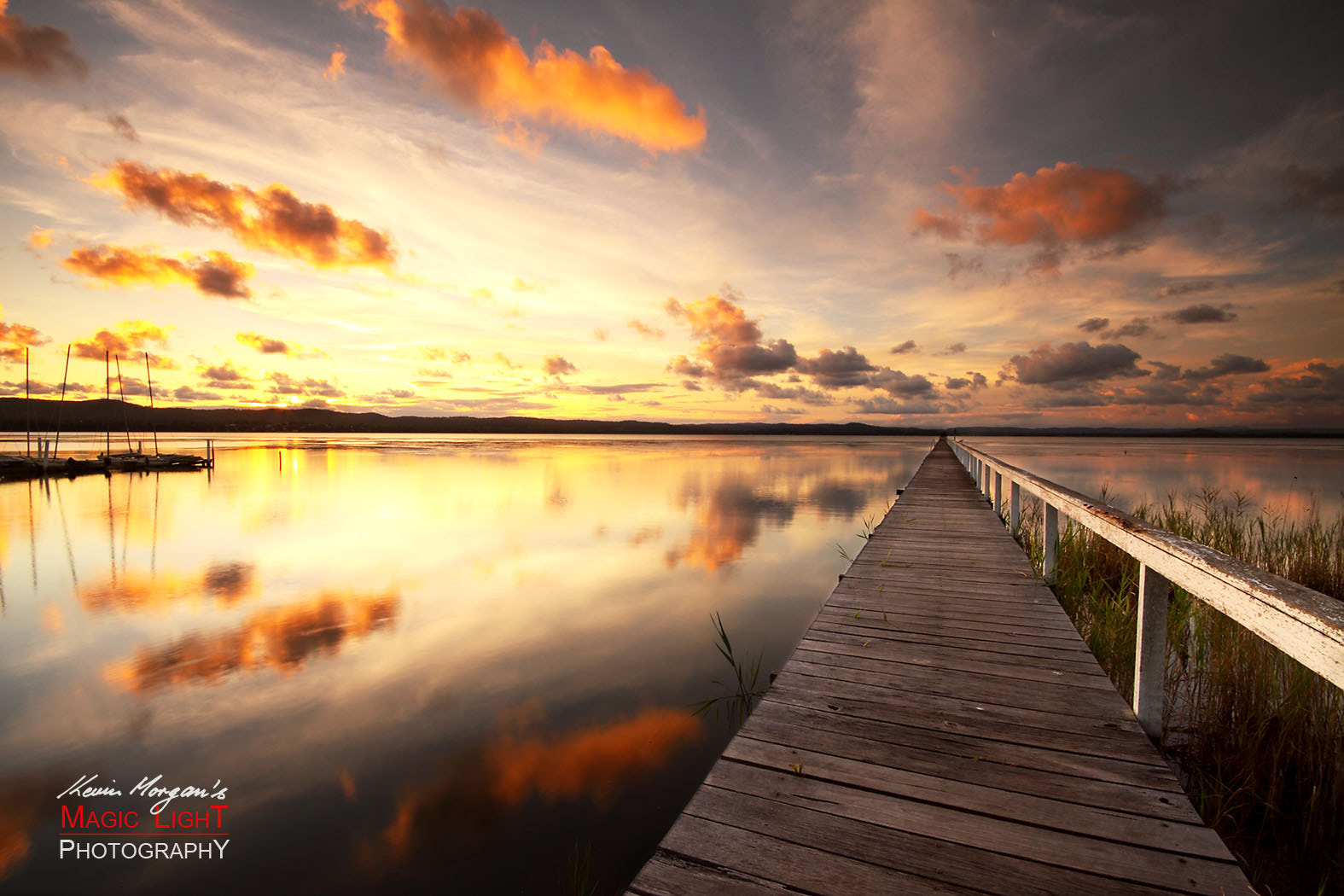 Photograph Long Jetty Sunset Reflections by Kevin Morgan on 500px