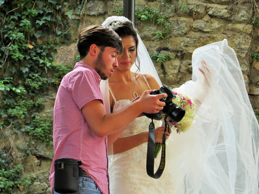Wedding photography - Bride and the Photographer Excitement by Caglayan Sonmez on 500px.com