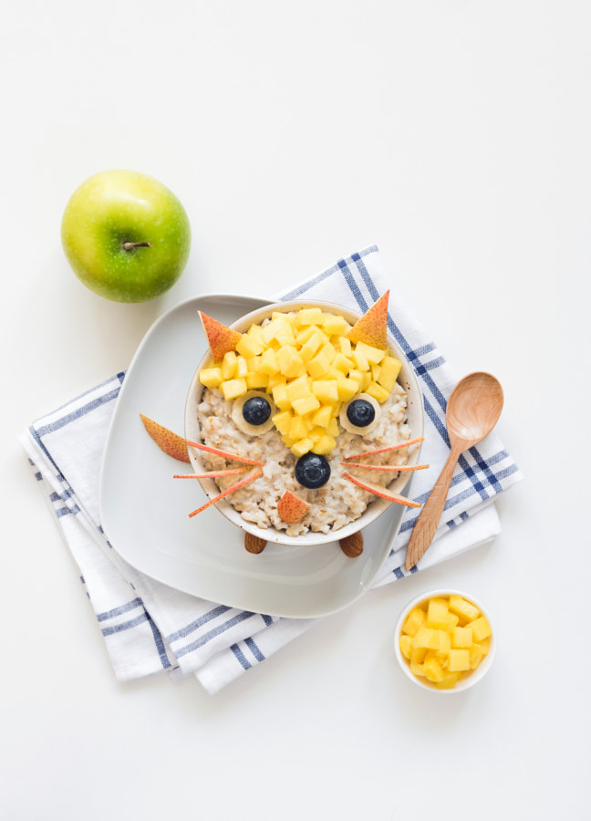 Oatmeal porridge with cute funny face, kids breakfast by Vladislav Nosick on 500px.com