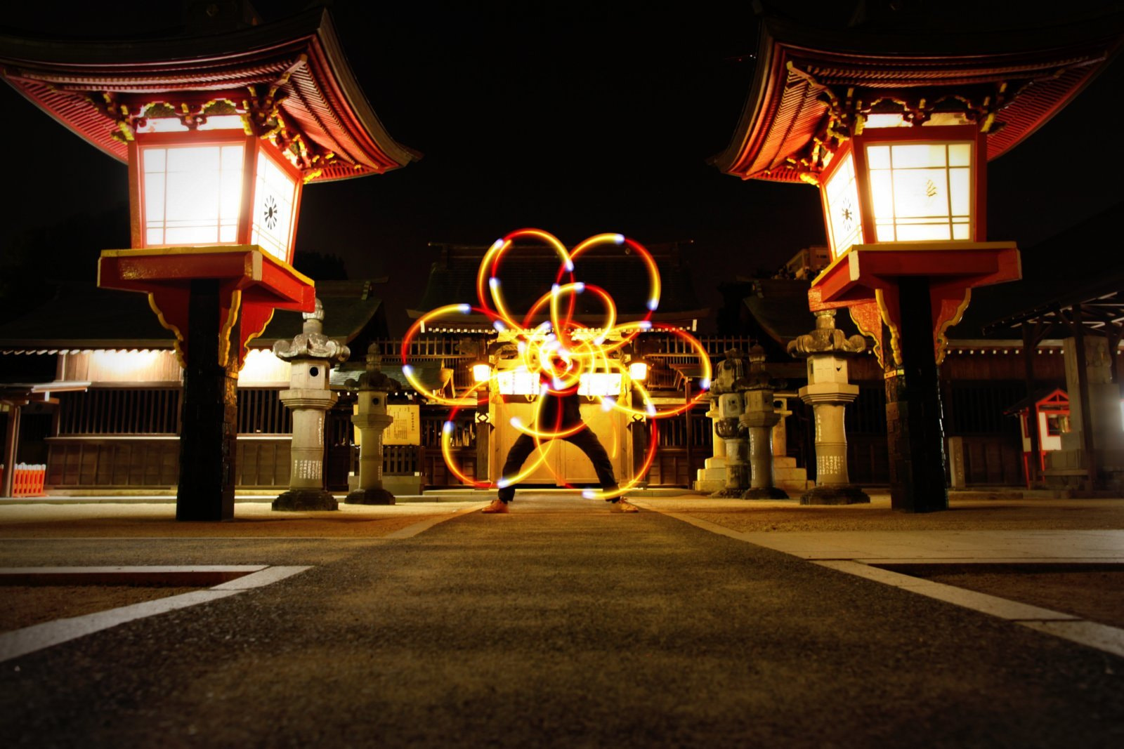 Photograph Podpoi fire in front of Jinja Gate by Yuta Poi on 500px