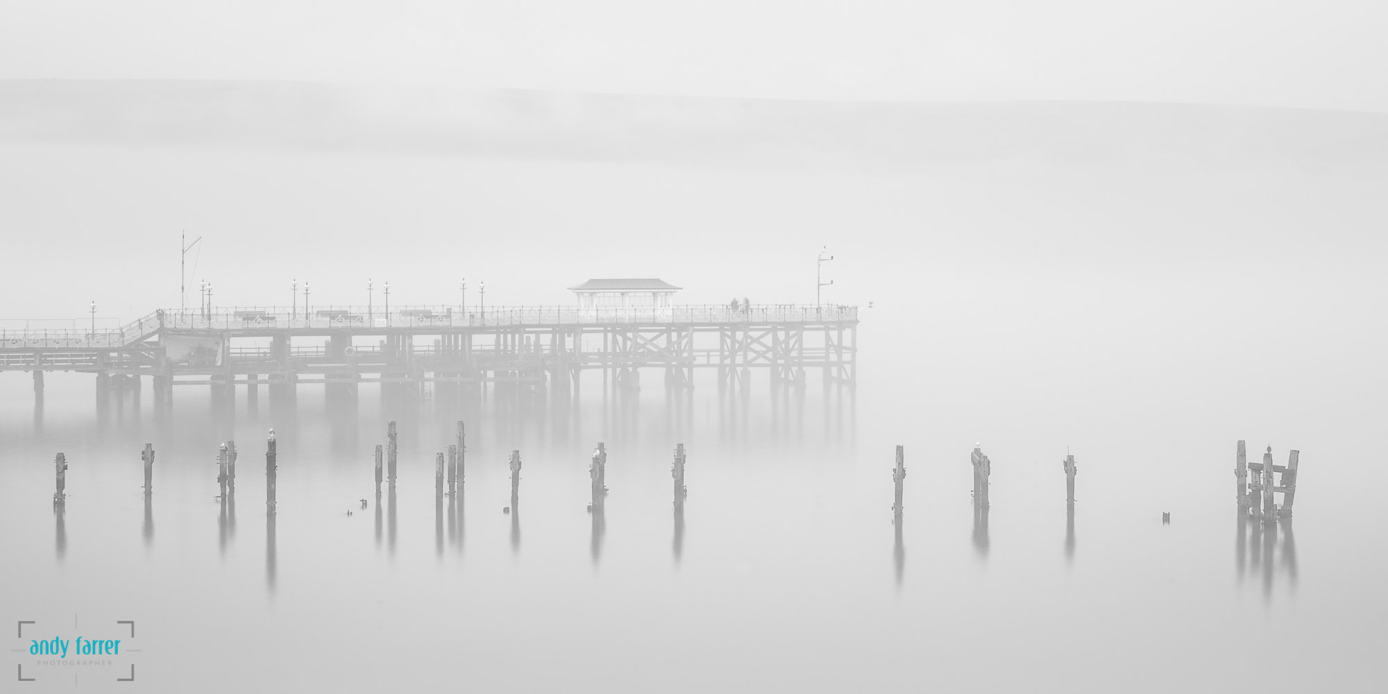 Photograph Swanage Piers in the Fog by Andy Farrer on 500px