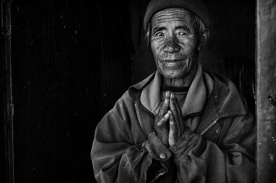 A monk from Nyphu monastery, near the cave city of Chosar, Upper Mustang.