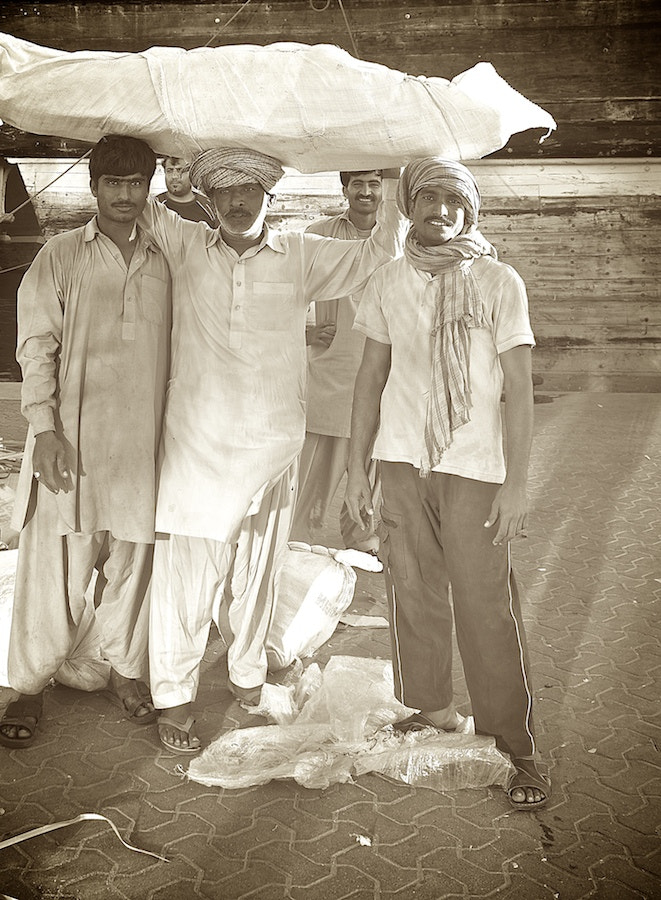 Photograph Dubai Dock Workers - Vintage Style by Sean Cheng on 500px