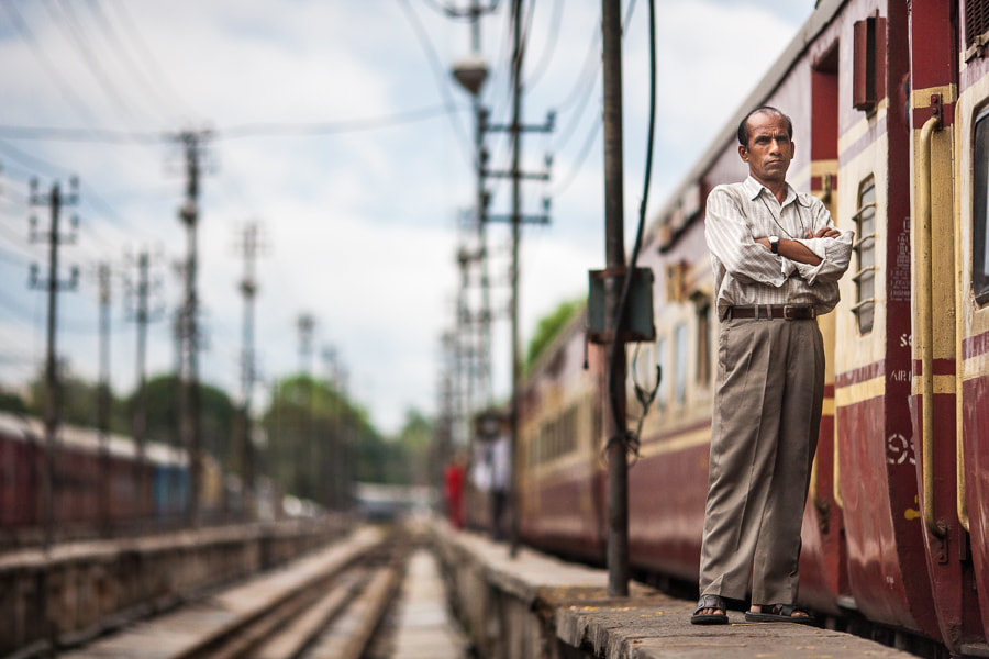 Photograph Indian man beside passenger train by Damon Lynch on 500px