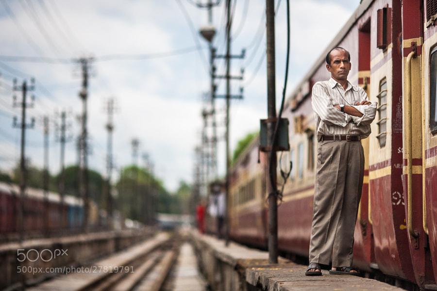 Photograph Indian man beside passenger train by Damon Lynch on 500px