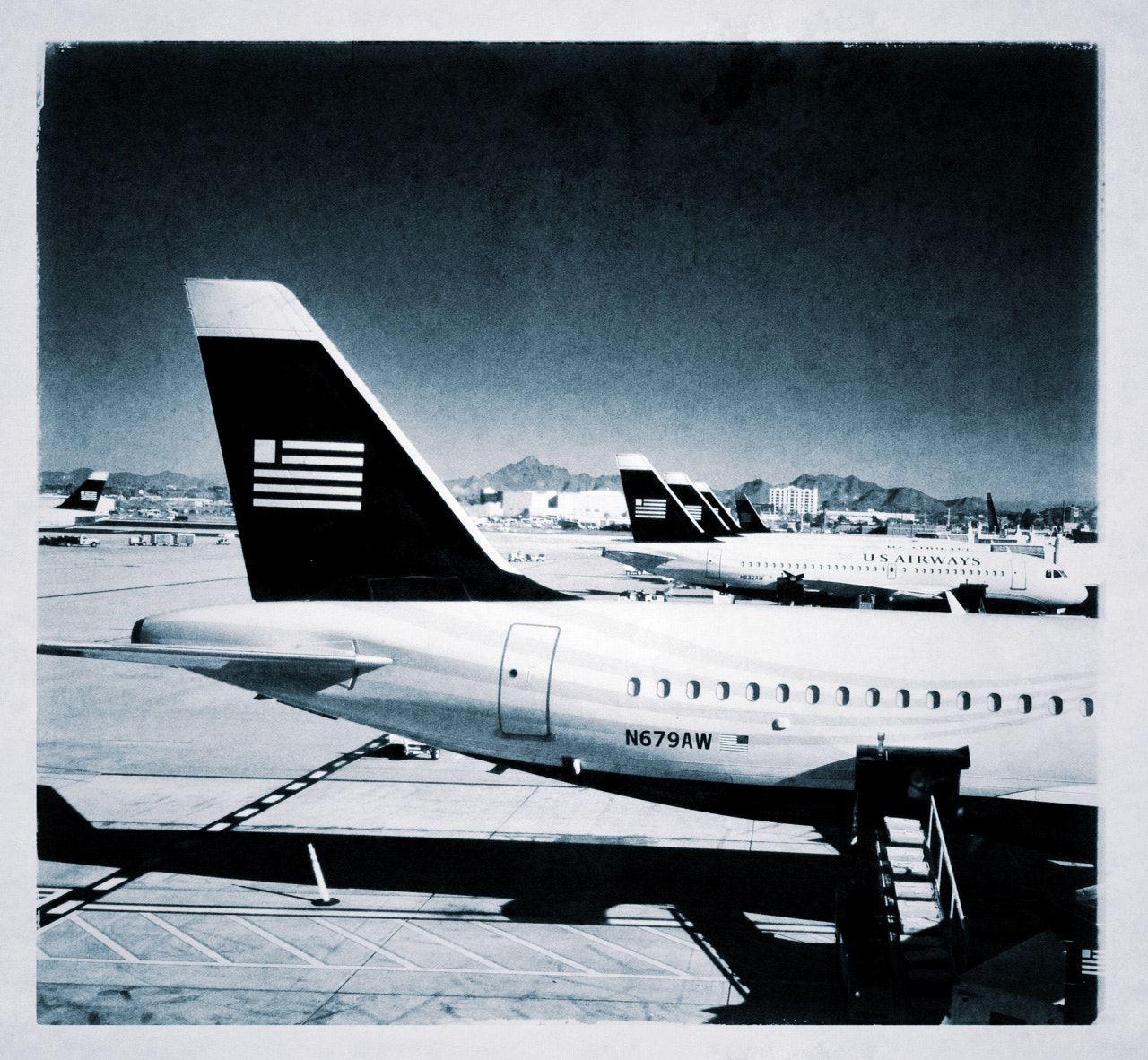 Photograph iPhone planes at their gates by Paul Bartell on 500px