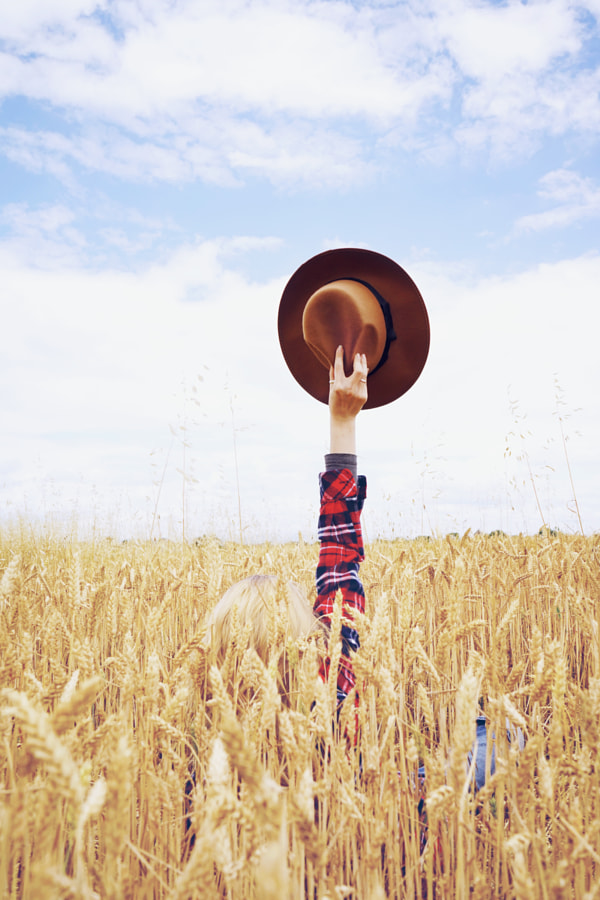 Back view of a young woman in a field of wheat by Sol Vazquez Cantero on 500px.com