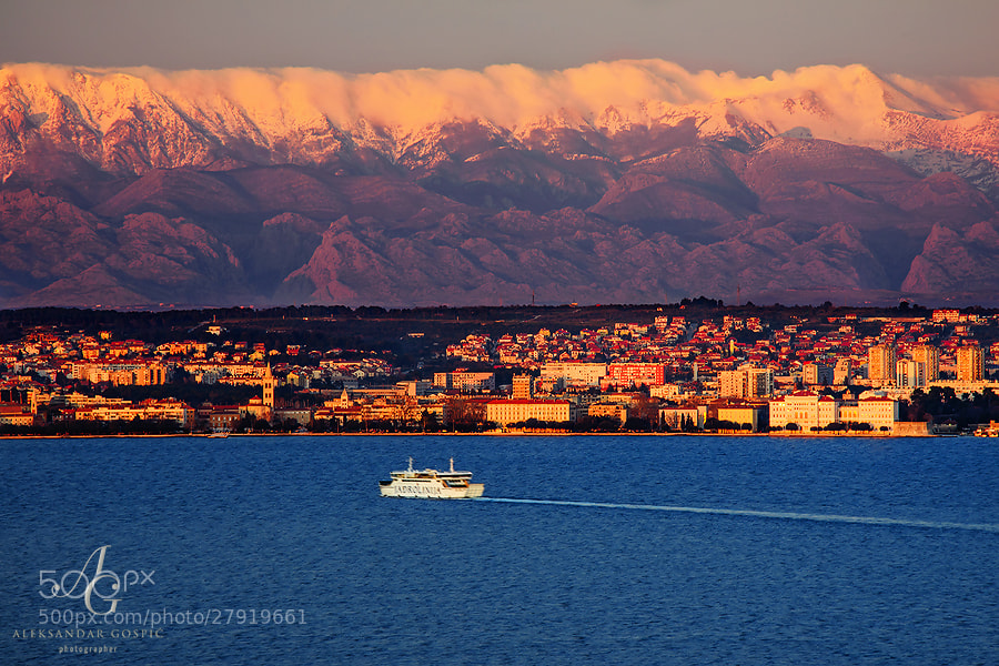 Zadar and Velebit mountain at the end of the day, seen across Zadar channel. On the left is Velika Paklenica canyon, on the right is Mala Paklenica canyon, both cut into the body of Velebit.  Mid Adriatic, Croatia
