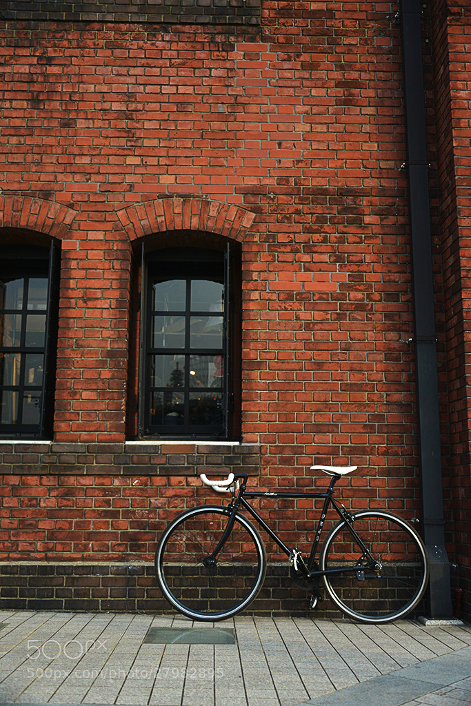 Photograph bicycles and a red brick warehouse 2 by t_aLee on 500px