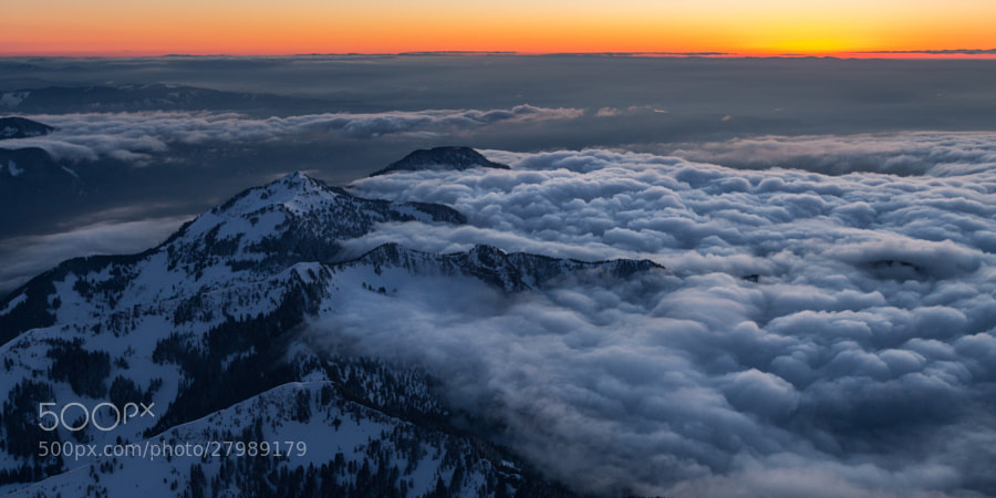 A marine layer settles in on the region, stopped by the foothills of Mount Rainier.