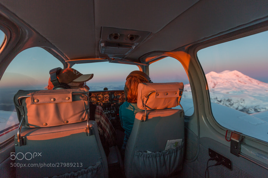 Rick and Jan Lentz flying around Rainier at sunset.