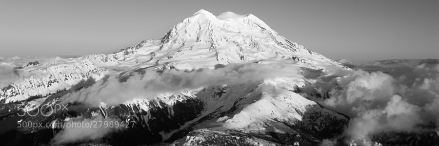 Clouds mingle with the lower slopes of Mount Rainier.