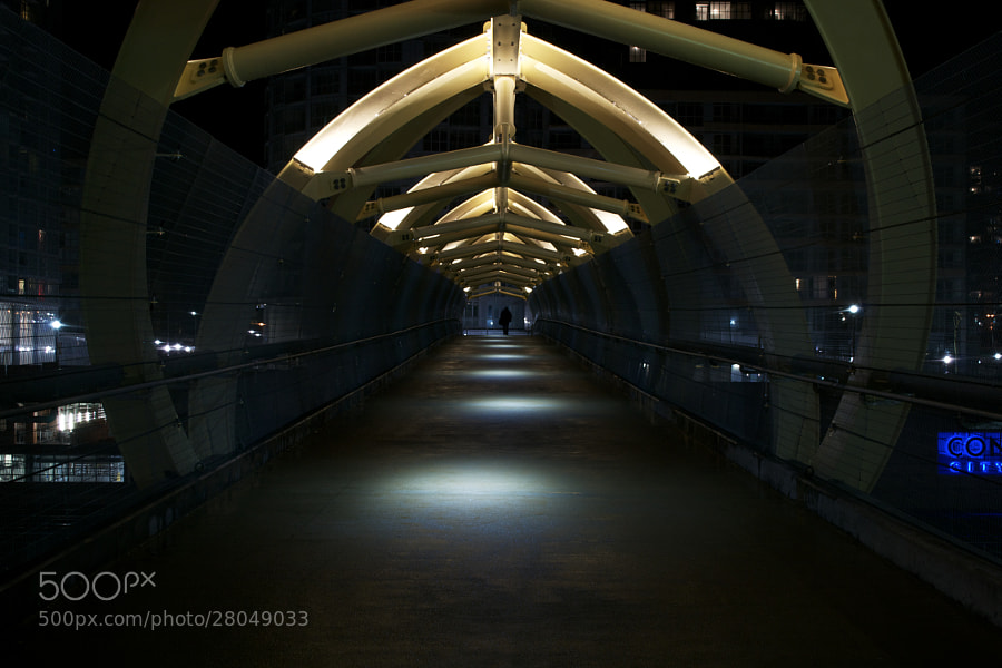 The CityPlace footbridge at night.