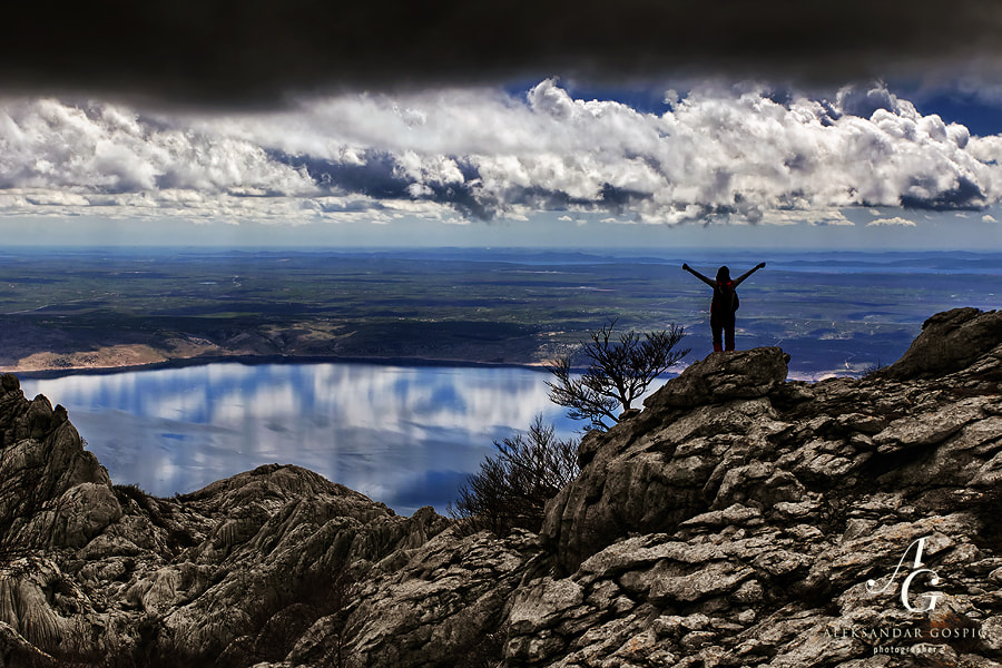 Comforting view towards Velebit channel, plains of Ravni Kotari and distant islands of Zadar archipelago from the darkness of Velebit mountain, which was wrapped in heavy clouds