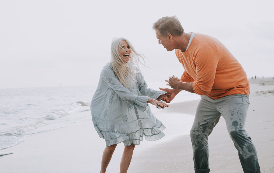 Happy senior couple spending time at the beach. Concepts about l by Cristian Negroni on 500px.com