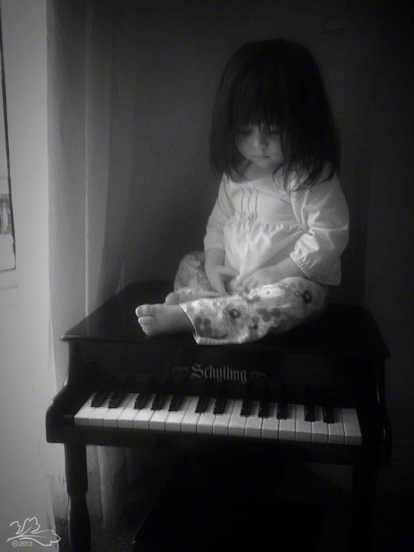 Child and piano