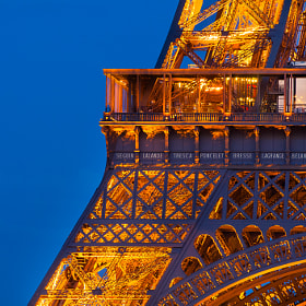 Detail view of the illuminated Eiffel Tower at night, Paris, France
