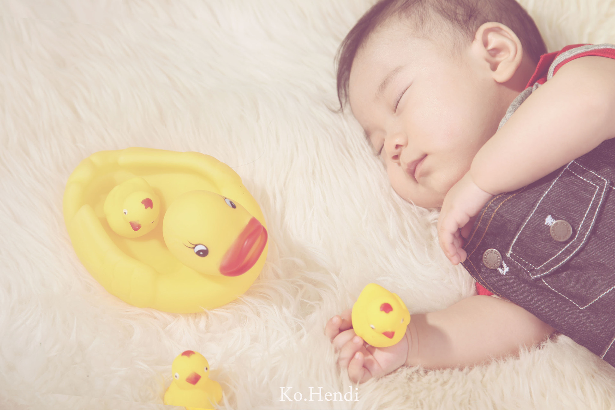 Photograph sleeping with duck by Hendi Ko on 500px