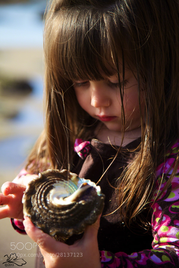 Child with seashell