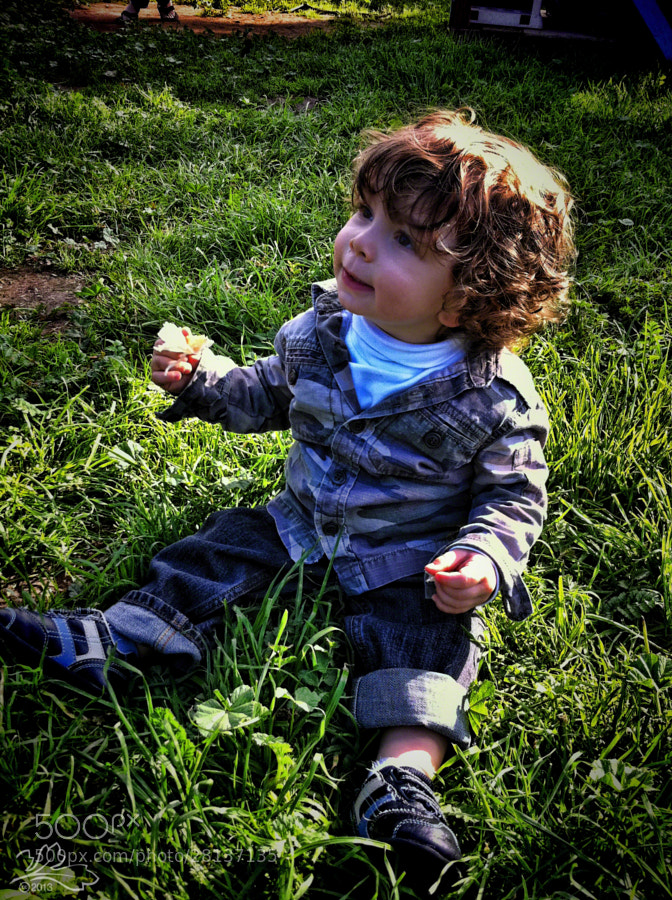 Child with halo in the grass