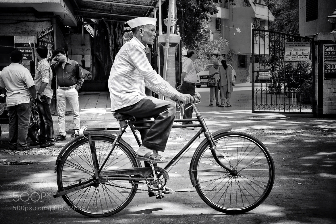Photograph Man on Bike by B C on 500px