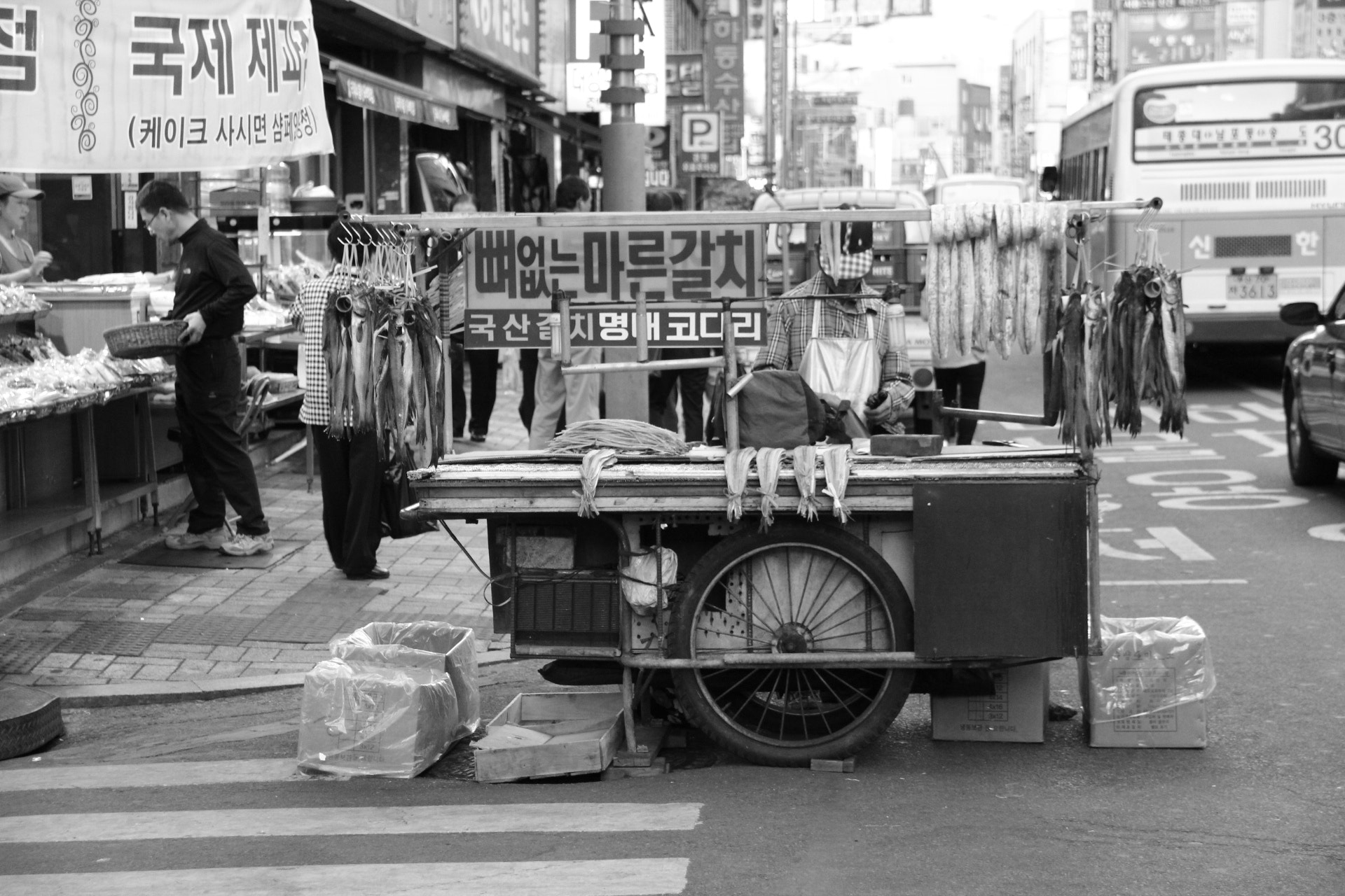 Photograph An old street vendor who is selling dried fish by SUNGMIN HAN on 500px