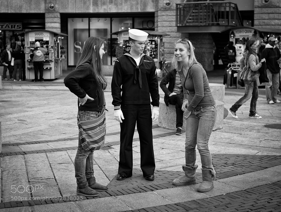 Young American sailor is the centre of female attention in a Boston mall