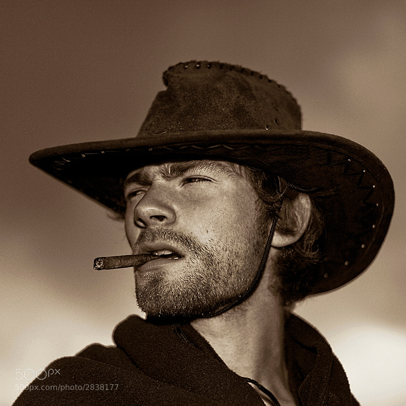 I took this for a cowboy challenge and I thought of a scene from Sergio Leone's spaghetti-western trilogy; the classic image of Clint Eastwood' s character, ice-cool, the man with no name and nothing to answer to except the cigar in his mouth…  The model is my son, Ingi.  This image is available on highest quality printing in multiple sizes : http://www.imagio.is