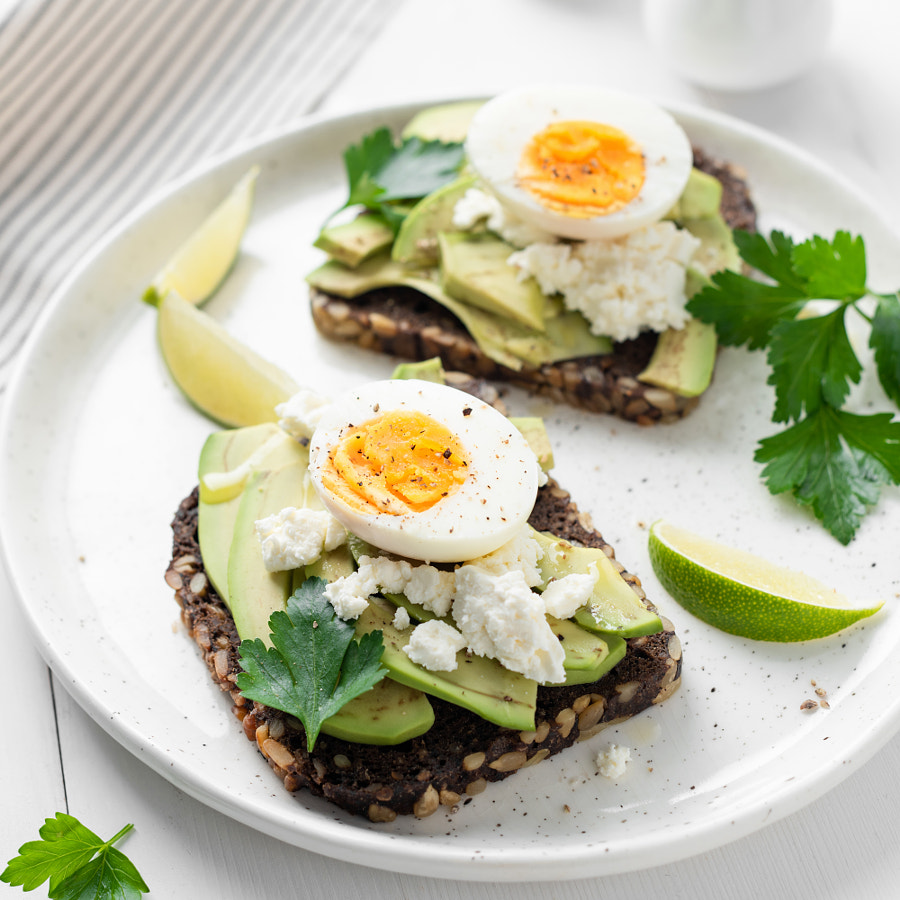 Toast with avocado, feta cheese and boiled egg by Vladislav Nosick on 500px.com