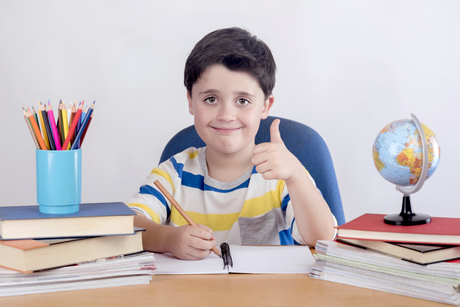 Smiling boy studying by Esther Moreno on 500px.com