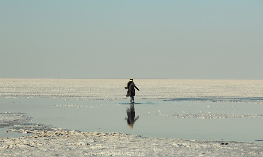 Reflection of a girl in the salt lake by The Storygrapher on 500px.com