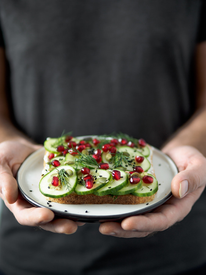 Vegan sandwich with cucmber in male hands by Fascinadora on 500px.com